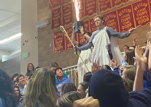 Adam Leclair '20, member of Associated Student Body (ASB), parts the student body and poses in celebration of the CCHS Winter sports rally. The loud display, a tradition senior classes have had for years at CCHS, also fostered a shirtless Merrick McCadden '20 and a rumbling cheer.