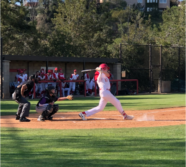 Charlie Mirer '22 hits a ground ball for a base hit early this month. The CCHS junior varsity baseball team went on to beat their opponent, Santana High School, 5-4, continuing their undefeated winning streak.
