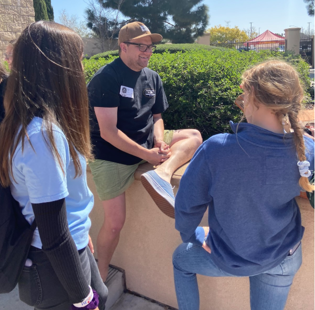Mr. Harrison Trubitt discusses upcoming service opportunities for the St. Thérèse of Carmel youth ministry group. The dialogue occurred at lunch on Friday and the group offered pizza for attendees.