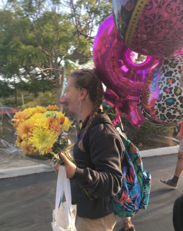 "Clare Hannon '20 celebrates her birthday with flowers, treats, and balloons, including a large ""18"" to signify her coming of age."