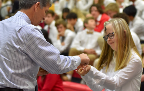 CCHS options student Gabrielle Scholar '23 receives the Eucharist after February's Ash Wednesday Mass.