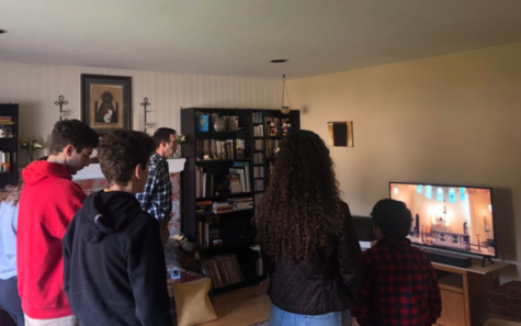 The Bacich family gathers in their living room to watch Mass together, as currently all Catholic Masses have been cancelled in light of the quarantine due to COVID-19.