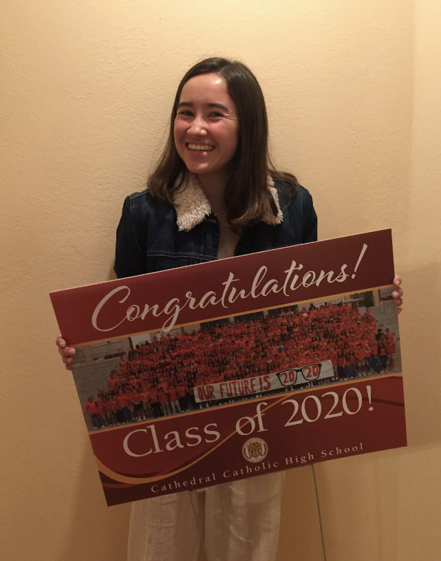 Maya+Redington+%E2%80%9820+poses+with+her+senior+sign%2C+a+gift+from+CCHS+to+honor+the+seniors+as+they+complete+their+high+school+career+at+home+during+the+COVID-19+pandemic.+%0A