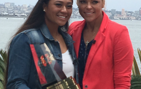 egan Faraimo '18 poses with Mrs. Jennie Finch, a former collegiate softball All-American, a medal winning Olympian, and a retired 2-time pro All-Star, with Faraimo's 2018 Gatorade National Softball Player of the Year award.